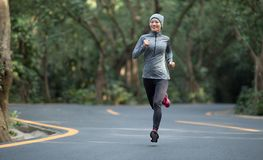 Woman running at park road stock photos