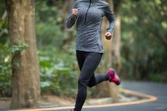 Woman running at park road stock image