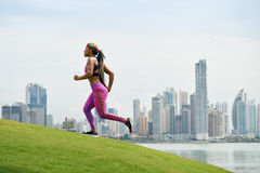 Woman Running And Working Out At Morning In The City Royalty Free Stock Image