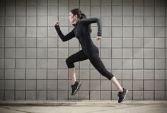 Woman Running During a Workout Royalty Free Stock Image