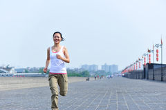 Woman running at xian city wall Stock Image
