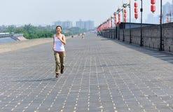 Woman running at xian city wall Stock Photo