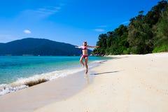 Woman runnnig on beach Royalty Free Stock Photos