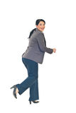 Woman runnung and looking back Stock Images