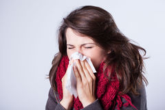 Woman with runny nose. Having autumn flu Stock Photography