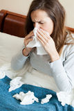 Woman with runny nose Stock Image