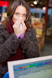 Woman With A Runny Nose In Pharmacy Royalty Free Stock Images