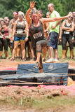 Woman Runs Across Floating Platforms At Extreme Obstacle Course Race Royalty Free Stock Photography
