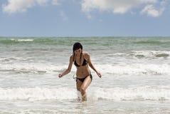 Woman runs on the beach stock photo