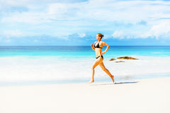 Woman runs on the beach Royalty Free Stock Images