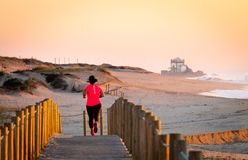 Woman Runs on Boardwalk stock images