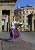 Woman runs with Bouquet Stock Photo