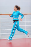 Woman runs on cruise liner deck Stock Photo
