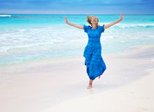 The woman runs on an ocean coast, Maldives Royalty Free Stock Photo