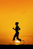 Woman runs with prosthesis Royalty Free Stock Image