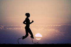 Woman runs with prosthesis Stock Images