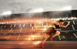 Woman runs in a race to the stadium Royalty Free Stock Image