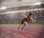 Woman runs in a race to the stadium royalty free stock images