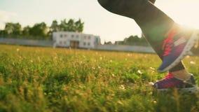 Woman runs through the stadium at sunset stock footage
