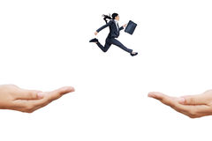 Woman runs to chase a chance. Hispanic woman carrying briefcase jump through hands, symboling an effort to chase a chance Royalty Free Stock Image