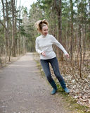 The woman runs on the track in the spring wood Royalty Free Stock Photography