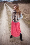 Woman on rural road Royalty Free Stock Image