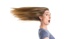 Woman in rush. Stress - Woman in a rush - flowing hair in wind - isolated on white stock image