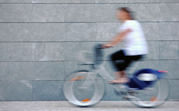 Woman rushing on a bike Royalty Free Stock Images