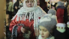 Woman in Russian Folc Costume. Moscow, Russia - December 1, 2016: Senior woman in traditional russian folk costume at a christmas fair on December 1, 2016 stock footage