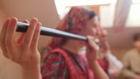Woman in Russian folk costume playing a vintage flute stock video
