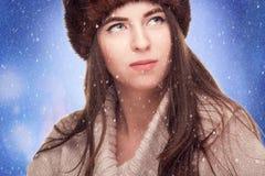 Woman in russian hat in winter scene Stock Images