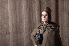 Woman in Russian military uniform with camera. Female war correspondent during the second world war. Young woman in Russian military uniform. Female war stock photography