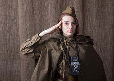 Woman in Russian military uniform with camera. Female war correspondent during the second world war. Young woman in Russian military uniform. Female war royalty free stock photos
