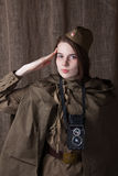 Woman in Russian military uniform with camera. Female war correspondent during the second world war. Young woman in Russian military uniform. Female war royalty free stock images