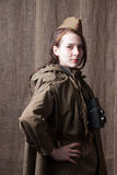 Woman in Russian military uniform with camera. Female war correspondent during the second world war. Young woman in Russian military uniform. Female war stock photos