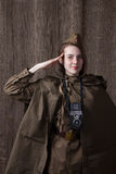 Woman in Russian military uniform with camera. Female war correspondent during the second world war. Young woman in Russian military uniform. Female war stock photo