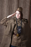Woman in Russian military uniform with camera. Female war correspondent during the second world war. Young woman in Russian military uniform. Female war royalty free stock image