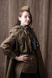Woman in Russian military uniform with camera. Female war correspondent during the second world war. Royalty Free Stock Images