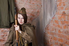 Woman in Russian military uniform with rifle. Female soldier during the second world war. Stock Image