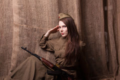 Woman in Russian military uniform with rifle. Female soldier during the second world war. Royalty Free Stock Photos