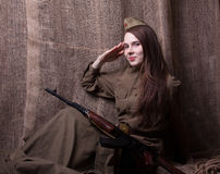 Woman in Russian military uniform with rifle. Female soldier during the second world war. Royalty Free Stock Images
