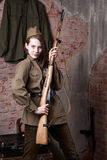 Woman in Russian military uniform with rifle. Female soldier during the second world war. Stock Images