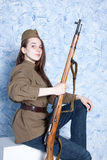 Woman in Russian military uniform with rifle. Female soldier during the second world war. Royalty Free Stock Photography