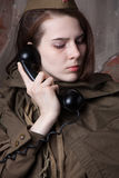 Woman in Russian military uniform speaks on phone. Female soldier during the second world war. Stock Photos