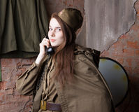 Woman in Russian military uniform speaks on phone. Female soldier during the second world war. Royalty Free Stock Photos