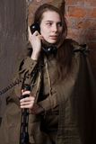Woman in Russian military uniform speaks on phone. Female soldier during the second world war. Stock Image