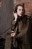 Woman in Russian military uniform speaks on phone. Female soldier during the second world war. Stock Photo