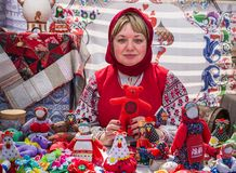 Moscow, Victory Park, 11 June 2018: woman in Russian national costume selling traditional dolls in the Park stock photos