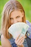 Woman with Russian roubles Stock Photography
