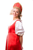 Woman in Russian traditional costume. Girl standing in Russian traditional costume. Woman is wearing sarafan and kokoshnik . The girl in red old russian dress royalty free stock photography